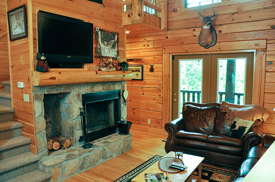 Sit by the fireplace in your Tennessee rental cabin.