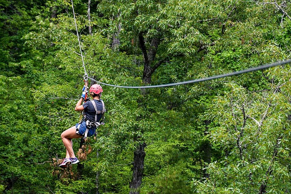 Soar through the trees on a zip line in Pigeon Forge